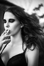 Beautiful young girl smoking cigarette dramatic portrait of a closeup Stock Photos
