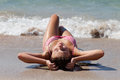 Beautiful young girl sunbathing on sand Royalty Free Stock Photography