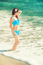 Beautiful young girl in a swimsuit at the seaside travel Royalty Free Stock Images