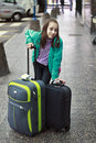 Beautiful young girl waiting with two suitcases Stock Images