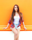 Beautiful young girl wearing a shirt and shorts in city Royalty Free Stock Photo
