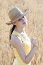 Beautiful young girl on wheat field Royalty Free Stock Images