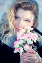 Beautiful young girl in winter day wiht flowers Stock Images