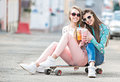 Beautiful young girls hipster girlfriends posing Royalty Free Stock Photo