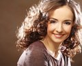 Beautiful young happy smiling woman close up portrait of curly Royalty Free Stock Photography
