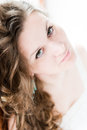 Beautiful young happy smiling woman with long curly portrait of hair over grey background Royalty Free Stock Images