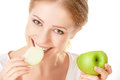 Beautiful young healthy girl eating an apple on a white background Stock Images