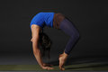 Beautiful young healthy woman doing yoga on grey background woman working yoga exercise instructor in photo studio Royalty Free Stock Photos