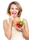 Beautiful young healthy woman eating a salad isolated on white Royalty Free Stock Photography
