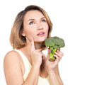 Beautiful young healthy woman holds broccoli isolated on white Royalty Free Stock Photography