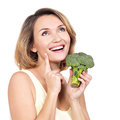 Beautiful young healthy woman holds broccoli isolated on white Royalty Free Stock Images