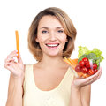 Beautiful young healthy woman with a plate of vegetables isolated on white Stock Images