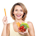 Beautiful young healthy woman with a plate of vegetables isolated on white Royalty Free Stock Image