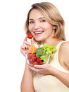 Beautiful young healthy woman with a plate of vegetables isolated on white Stock Photo