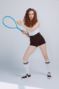 Beautiful young hipster girl playing tennis with racket and ball Royalty Free Stock Photo