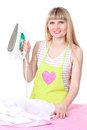Beautiful young housewife with iron Stock Photo