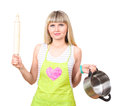 Beautiful young housewife with pan and plunger Royalty Free Stock Images