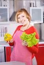 Beautiful young housewife at red kitchen Stock Images
