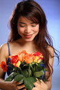 Beautiful young Japanese girl receives flowers Stock Photos