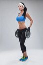 Beautiful young jogging woman exercises with dumbbells Isolated Royalty Free Stock Photo