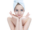 Beautiful young lady applying moisturizing creme skin care concept photos of attractive girl on white background Royalty Free Stock Photos