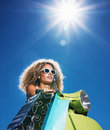 Beautiful young lady carrying shopping bag Royalty Free Stock Photo