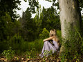Beautiful young lady in the forest Stock Photos