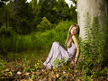 Beautiful young lady in the forest Stock Photo
