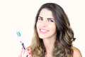 Beautiful young lady holding toothbrush and smiling closeup of Stock Photos