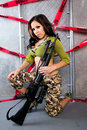 Beautiful Young Lady Posing in Camouflage Royalty Free Stock Photography