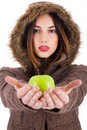 Beautiful young lady showing green apple Royalty Free Stock Photos