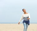 Beautiful young lady walking on the beach portrait of a copy space Royalty Free Stock Photo
