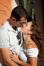 Beautiful young lovers about to kiss in the aftern Royalty Free Stock Photo