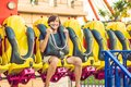Beautiful, young man having fun at an amusement park Royalty Free Stock Photo