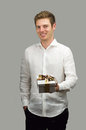 Beautiful young man smiling offering nice gift box Royalty Free Stock Photo