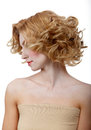 Beautiful young model with curly hair on white background Royalty Free Stock Photography