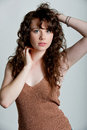 Beautiful young model with long curly hair posing in a studio woman Stock Photography