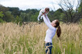 Beautiful young mother with a baby girl in flower field Royalty Free Stock Photo