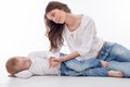 Beautiful young mother is having rest with her kid pretty women lying near son they are holding hands and looking at each other Stock Photography