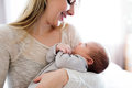 Beautiful young mother holding baby son in her arms Royalty Free Stock Photo
