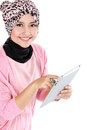 Beautiful young muslim woman holding tablet computer and looking at camera Royalty Free Stock Photo