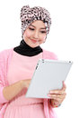 Beautiful young muslim woman using tablet computer isolated over white background Royalty Free Stock Photos