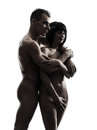 Beautiful young naked couple portrait silhouette one caucasian y in studio on white background Stock Photo