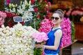 Beautiful young Parisian woman buying flowers Royalty Free Stock Photo