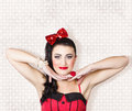 Beautiful young pin up woman posing on grunge studio background with brunette hairstyle and classic make Stock Photo