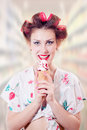 Beautiful young pinup woman eating ice cream cone Royalty Free Stock Photo