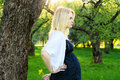Beautiful young pregnant woman with wild flower Royalty Free Stock Photos