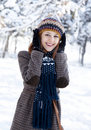 Beautiful young red-haired woman in winter park Royalty Free Stock Image