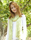 Beautiful young redhead woman near the apple tree Stock Photography