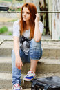 Beautiful young sad girl sitting on staircase Stock Photos